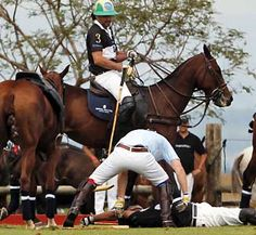Prince Harry rescuing another Polo player after falling off his horse.