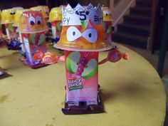 Juice Box Robots ..I made these for my son's 5th birthday treat for school.  Perfect store bought snack & easy to put together.  Use a fruit cup/applesauce cup and stick it to the top of a juice box.  I used sticky dots/tape for scrapbooking.  Next stick 2 feet on.  I used Airheads and mini Hershey bars.  Next stick 2 suckers through the back in between the straw for arms.  Lastly make a face.  I cut out white eyes and used a black Sharpie to color with.  My sons of course has the Birthday…