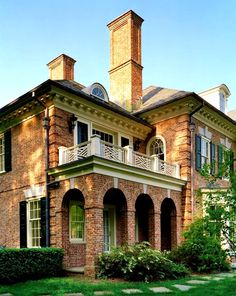 traditional brick home with balcony