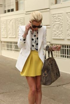White shirt with black polka dots and mustard skirt