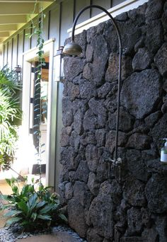 Outdoor shower ... love the volcanic rock wall