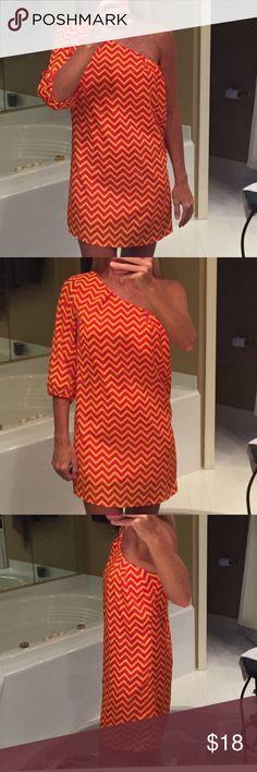 """Vestique one shoulder dress Yellow & red-orange chevron dress with full lining & side zip.   Outer is polyester or rayon material.  It only has a tag for the lining.  Length is 23 inches armpit hem to bottom hem.  Model is 5'7"""".  Bought at Vestique Boutique (several stores in carolinas). Vestique Dresses One Shoulder"""