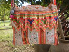 Hmong Vintage Tribal Textile Upcycled Hand Made Bag. $48.00, via Etsy.