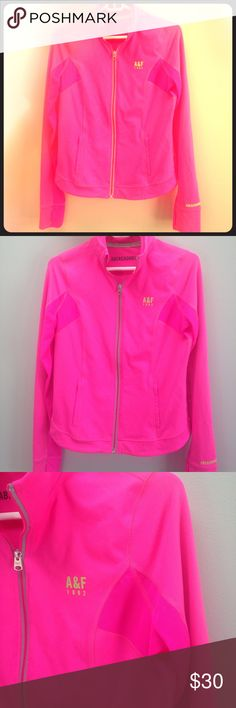 Abercrombie Zip Up Vibrant pink color with bright green A&F label on left side. Two front zip pockets. Mesh under arm pits and down arm. Thumb holes. Full zip. Last pic shows mesh along whole back arm. Only worn 1 time Abercrombie & Fitch Tops