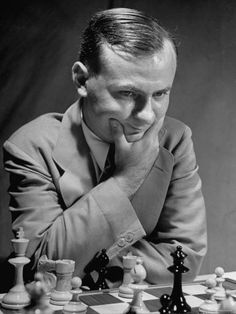American International Ace Reuben Fine  Concentrating on the Chess Game During the Tournament by Walter Sanders