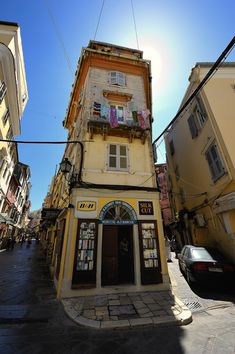 Narrow streets of Kerkyra, architecture of Corfu island Greece Corfu Island, Corfu Greece, Greek Islands, Old Houses, Light Colors, Times Square, Entryway, Fair Grounds, The Incredibles