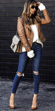 Sasha Simon + tan coloured leather jacket + cream knit sweater + distressed denim jeans + suede heels + chic shades.   Brands not specified.