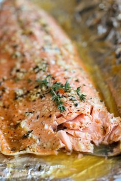 Honey-Garlic-Thyme Salmon Baked in Foil — a super flavorful, practically-foolproof way to cook salmon, via @damndelicious