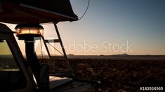 Stock Video of A close-up timelapse at sunrise of a semi silhouette offroad safari vehicle with a rooftop tent in a remote camping setting and golden light in the Karoo, South Africa at Adobe Stock Roof Top Tent, Stock Video, Rooftop, Stock Footage, Offroad, Close Up, South Africa, 4x4, Safari