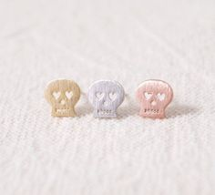 SKULL studs earrings with heart eyes in gold, silver, or rose gold... day of the dead ...but totes cute ...cuz, you know, heart eyes. LilahV