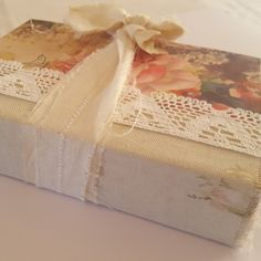 Hardcover journal with a floral cover and fabric on the spine. Lots of space for writing and memory keeping.