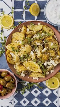 The Best Greek Potatoes There are roast potatoes, and then there are roast Greek Potatoes. This recipe is next level. Delicious new potatoes coated in olive oil, lemon juice and greek herbs and baked to perfection before getting a sprinkling with feta and Easy Healthy Recipes, Vegetarian Recipes, Cooking Recipes, Vegetarian Side Dishes, Cooking Tips, Potato Dishes, Potato Recipes, Vegetable Dishes, Vegetable Recipes