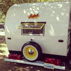 Vintage trailer with cute yellow accents
