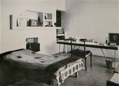 Pierre Jeanneret's Chandigarh House: Bedroom with Indian charpoy (rope bed) covered with a tie-dyed bedcover and a desk plus chairs of his own design, c.1955 | Photo: Lucien Hervé