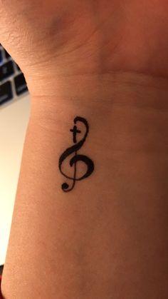 Music cross tattoo