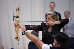 Countess of Wessex tries archery with spinal patients @SMStadium before unveiling the Stoke Mandeville Hall of Fame