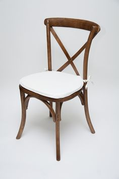Crossback Chair in fruitwood with ivory cushion.