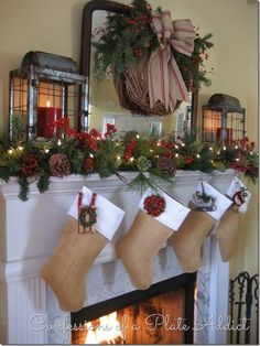 Christmas Mantel: Awesome grapevine wreath with gorgeous burlap bow, Burlap Stockings, and lanterns!!