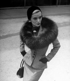 Unknown woman from 1950's wearing a tailored, 4 button tweed suit with a notch lapel. Accompanied by a suede glove, patent leather handbag, black velvet skull cap and a stunning mink oval stole. #1950s #Chic #Daywear