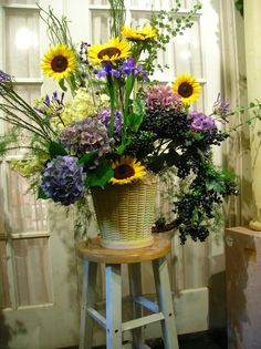 Back with the crowd favourite, Hydrangeas!  this time paired with sunflowers, iris, stock, and a berry garland.