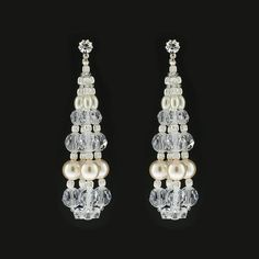 "Sleek, contemporary styling in crystal and pearl. - 2 ¾"" long - Single crystal stud at the post - 4 columns of beading, attached at the bottom - Clear Swarovski® crystal, cream pearl - Assembled in US                                                                                                                                                                                 More"