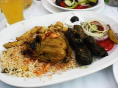 Stuffed Peppers with Stuffed Vine Leaves, Rice, chips and Salad at The Akropolis, Kriopigi, Greece