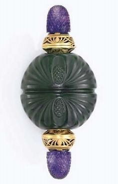 AN ART NOUVEAU NEPHRITE, AMETHYST AND GOLD SCENT BOTTLE, BY BOUCHERON. The circular carved nephrite bottle decorated with pine cone motifs, accented by matte gold chased and openwork terminals, each opening to reveal a nephrite stopper, accented by carved amethyst finials, circa 1900, with French importation marks Signed Boucheron, Paris. #boucheron #ArtNouveau #perfumeBottle ♥≻★≺♥