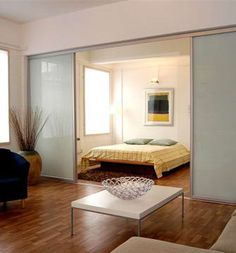 Our room dividers are constructed using contemporary anodised aluminium frames. They allow the creation of additional rooms which can include a study or perhaps a second bedroom by fitting a room divider into an existing living room. Acting as a moveable partition, the sliding doors can also be used with a single track to bi part adjacent to an existing wall. The room divider system can also be used to create a walk in wardrobe, in conjunction with our Apollo Storage system.