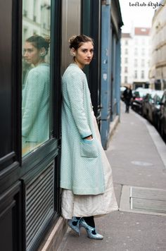 Womenswear Street Style. Jenny Walton wearing Miu Miu glitter shoes, pastel coat and vintage skirt after Lanvin show by Ángel Robles. Fashion Photography from Paris Fashion Week.