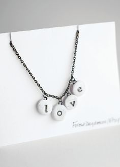 Polymer Clay Necklace Stamped Love Pendant Chain. $25.00, via Etsy.