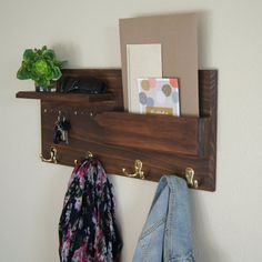 Keep your home stylishly organized with this coat rack, a Midnight Woodworks original design. Our handcrafted entryway organizer is an excellent entryway storage solution. Perfect for mail, keys, coats, backpacks and other necessities! This custom built flush-mount one-shelf organizer is made using solid wood stained Walnut but can be custom ordered, see photo #5 for stain and hook options. Four polished brass double coat hooks provide storage for your bags, backpacks and other…