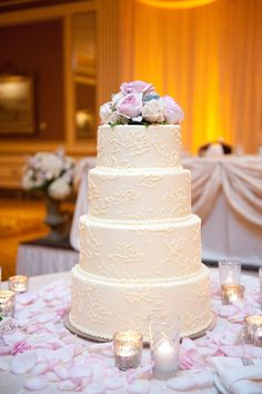 The Cake • The ivory piping on this white chocolate ganache cake was designed to mimic the lace on the bride's gown.  Photo byEmily Steffen Photography; Cake bySimma's Bakery