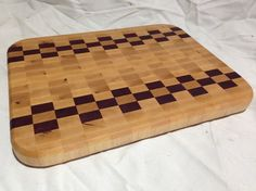 Here's another unique design to our checker board pattern end grain cutting board. Remember, end grain cutting boards are super great for your knives. Won't dull them easily. Goes with the flow of your knife when you cut.