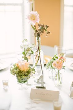 delicate centerpieces, photo by Mustard Seed Photography http://ruffledblog.com/rustic-texas-wedding #weddingreception #pinkflowers