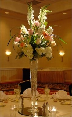 TABLE CENTERPIECES - Pink/White floral arrangement in tall crystal vase on a round mirror, crystal votives surround #Christmas #thanksgiving #Holiday #quote