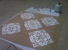 Stencil the burlap table toppers.  Brilliant!!