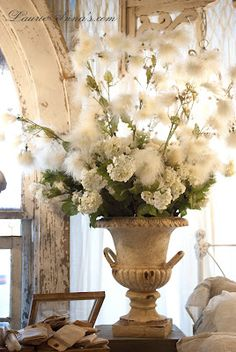 Flower in an urn.  From a post about softening your space.  Good tips for those who like romantic decorating (from LaurieAnna's Vintage Home)