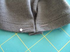 Tea Rose Home: make a small pleat in a t-shirt sleeve to give it a little more style, then add a button to hide the stitches.