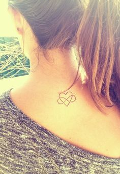 Heart, infinity tattoo sign on the top back