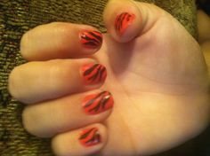 Lexi's stamped tiger nails