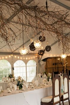 Baby's breath and fairy lights from the ceiling instead of this dark wood?