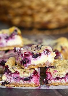Berry Cheesecake Crumble Bars ~ Packed full of berry cheesecake goodness, these are definitely one of our favorite Yummy Bar Recipes! A Quick, Easy & Delicious Treat for your entire Family! ~ http://www.julieseatsandtreats.com