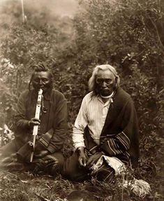 "Here for your enjoyment is an exciting photograph called ""The Smoke"". It was made in Montan in 1905 by Edward S. Curtis.  The photo illustrates Two Crow Indians sitting on the ground smoking a peace pipe."