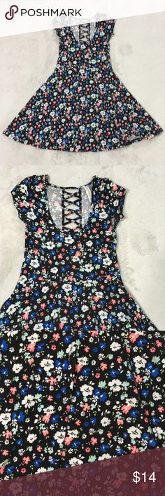 """Black floral dress by Aeropostale- X- Small neon Black dress with neon bright orange, blue, white flowers all over. Short sleeve. Open design down back with cross crosses. Skater dress style / fit and flare  Some wear under arms due to deodorant- see photos   Approx measurements when laying flat are   13"""" (or just under) across the bust 30.5"""" length from top of shoulder Aeropostale Dresses"""