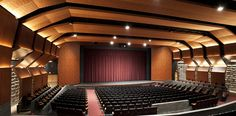 A Newmat stretch ceiling in an auditorium. Call to learn more. Auditorium Design, Auditorium Architecture, Auditorium Seating, Education Architecture, Architecture Plan, Green School, Theatre Design, Arts Theatre, Gymnasium