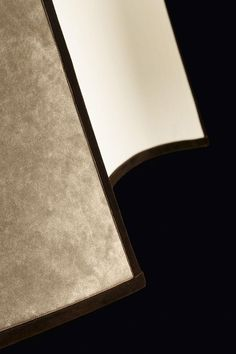 "Detail of the Pentagono lighting collection by Oasis, designed to fit gracefully into the most sophisticated interiors. Through its sand cotton lampshade, finished in rich, luxurious velvet, with a velvet grosgrain border for décor, ""Pentagono"" sheds a soft, comfortable light which imparts an immediate relaxing effect to the ambient it inhabits."