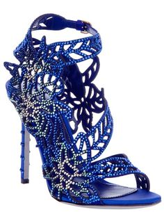 Blue leather sandals from Sergio Rossi featuring a round open toe, blue and gold crystal detailing, laser cut design, stiletto studded heel and an ankle strap with a buckle fastening.
