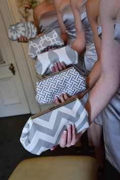 mix match bridemaid clutch set. so cute to make sure everyone can keep a few things with them without breaking the theme
