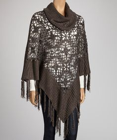 Bundling up doesn't have to mean styling down. Crocheted with twinkling sequins and trimmed with fanciful fringe, this turtleneck cape promises coziness with a runway-worthy twist.