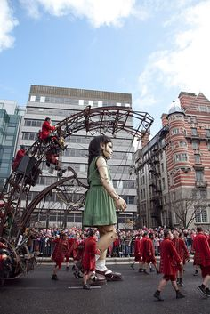 Little Girl Giant French street theatre company Royal de Luxe brought three giant marionettes to participate in Liverpool's Sea Odyssey Giant Spectacular. The show was performed in the street… Marionette Puppet, Puppets, Titanic, Nantes France, French Street, Roadside Attractions, Public Art, Liverpool, Street Art
